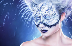 Fantasy make-up. Portrait of beautiful woman with fantasy make-up with lace and closed eyes on a blue background Royalty Free Stock Photography