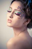 Fantasy makeup. Beautiful young girl with fantasy makeup Stock Photo