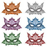 Fantasy Masks in different colours. Illustration of fantasy masks with Autumn leaf design in different colours Royalty Free Stock Photos