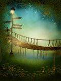 Fantasy meadow with a bridge. Fantasy meadow with a rope bridge and a lamp Stock Image