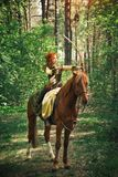 Fantasy medieval woman hunting in forest royalty free stock photo