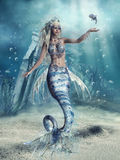 Fantasy mermaid and a fish. Fantasy scenery with a mermaid and a fish at the sea bottom Royalty Free Stock Photo