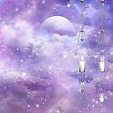 Fantasy moon and hanging candles Royalty Free Stock Photo