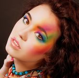 Fantasy. Multicolored Woman's Face. Vibrant Colorful Rainbow Makeup Stock Photos