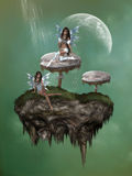 Fantasy mushroom with fairies Stock Photo