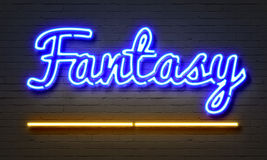 Fantasy neon sign on brick wall background. Royalty Free Stock Photo