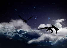 Fantasy night sky with hunting dragons Stock Photos