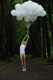 Fantasy. Nostalgic Svelte Woman with Air Balloons on Country Road Stock Image