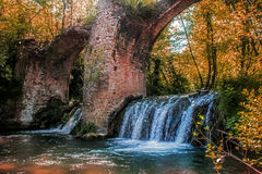 Fantasy old bridge and waterfall Stock Images