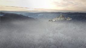 Fantasy panorama of a cathedral / castle in a winter forest
