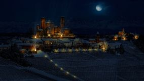 Fantasy photomanipulation of medieval landscape in winter on nig Royalty Free Stock Images