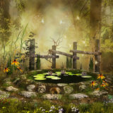 Fantasy pond in the forest. Fantasy pond with a wooden fence and yellow flowers in the forest Royalty Free Stock Image