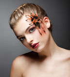 Fantasy. Portrait of beautiful Female Tamer with Spider. Fantastic Trendy Female Tamer with Spider Stock Images
