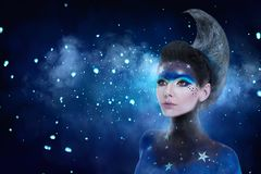 Fantasy portrait of moon woman with stars make-up and moon style hairdo. Fantasy portrait of young moon cosplay woman with stars make-up and moon style hairdo royalty free stock photos