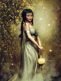 Fantasy priestess with a lamp Royalty Free Stock Images