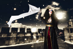 Fantasy princess awaiting prince charming rescue. Fantasy princess awaiting rescue from prince charming on palace rooftop when waving white cloth in the chill of Royalty Free Stock Photo