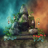 Fantasy rock with lanterns and flowers Royalty Free Stock Image