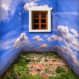 Fantasy room scenery with clouds, town and window. In countryside Stock Photo