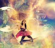 Fantasy room view. Creative young brunet with umbrella sitting at fantastic room Royalty Free Stock Photography
