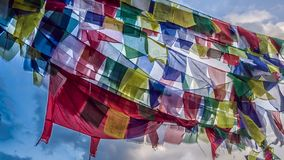 Fantasy scene of colorful praying flags with blue sky in the background. Sagarmatha Everest National Park, Nepal royalty free stock photos