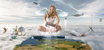 Fantasy scene - girl angel showering the earth with rain royalty free stock photos