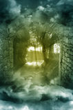 Fantasy scenery through arch. Fantasy forest with light rays through stone arch Stock Photo