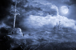 Fantasy scenery with sword. Fantasy sword in magic landscape with castle and moon Stock Photo