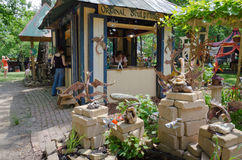 Fantasy Sculpture Garden. A tourist visits a merchant's booth near a fantasy sculpture garden at a Renaissance festival Stock Image