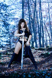 Fantasy sexy dress and sword Royalty Free Stock Images