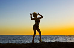 Fantasy Silhouette Dancer on Rocks at the Beach Stock Photos