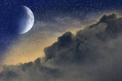 Fantasy sky. A fantasy sky with clouds, stars, rain and crescent moon Royalty Free Stock Images