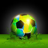 Fantasy soccer ball. Colorful soccer ball on a green grass Stock Photo