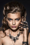 Fantasy. Spider sitting on pretty woman face. Creativity Royalty Free Stock Images