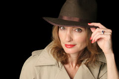 Fantasy Spy Woman. A beautiful, sexy woman dressed as a spy in a trenchcoat and fedora hat Stock Photos