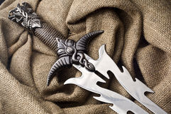 Fantasy steel dagger. Double blade dagger with decorated hilt Royalty Free Stock Images
