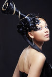 Fantasy style. Portrait of stylish woman with fantasy hairstyle and make-up Royalty Free Stock Photography