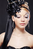 Fantasy style. Portrait of stylish woman with fantasy hairstyle and make-up Stock Photography
