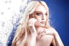Fantasy style photo of a beautiful blond woman. Stock Photo