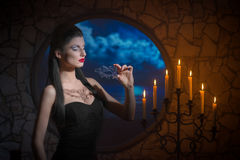 Demonic woman with a mask. Fantasy style portrait of demonic woman with lacy mask Royalty Free Stock Photo
