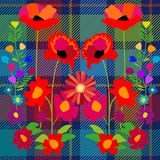 Fantasy summer wildflowers on blue textile background. Royalty Free Stock Photo