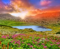 Fantasy sunset landscape with mountain and lake. royalty free stock photo