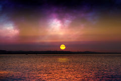 Fantasy sunset over sea Stock Images