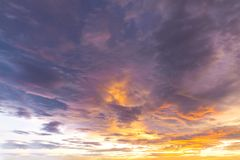 Fantasy sunset / sun rise sky with yellow and red light shining. Clouds and sky background and texture stock photography