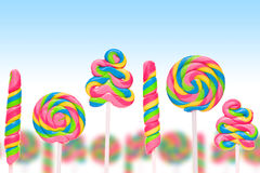 Fantasy sweet candy land with lollies. On blue background Stock Image