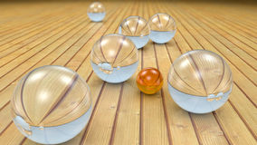 Fantasy transparent and colored realistic glass balls. Fantasy transparent and colored realistic glass balls on a realistic wood floor floor. Depth of field Stock Images