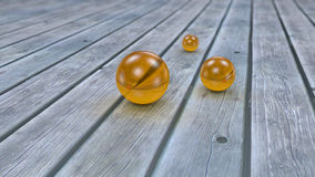 Fantasy transparent and colored realistic glass balls. Fantasy transparent and colored realistic glass balls on a realistic wood floor floor. Depth of field Royalty Free Stock Photography