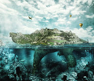 Fantasy turtle like an island. Huge turtle in ocean overgrown forests and mountains to the village and the castle in the shell floats like an island Royalty Free Stock Photography