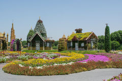 Fantasy village with houses and castles near the colorful flowerbeds. Fantasy looking village with houses and castles near the colorful flowerbeds royalty free stock images