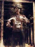 Voodoo sorcerer with an animal skull Royalty Free Stock Images