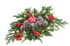 Fantasy Winter and Christmas Decoration. Fantasy winter and christmas table decoration with fly agaric mushroom ornament, holly, ivy, mistletoe, ivy, juniper and Royalty Free Stock Photo